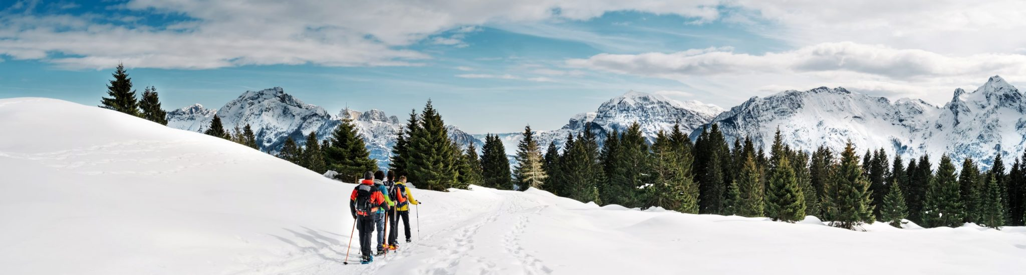 Friends,Practicing,Snowshoe,Trekking,In,The,Snowy,Mountains.,Dolomites,,Italy.